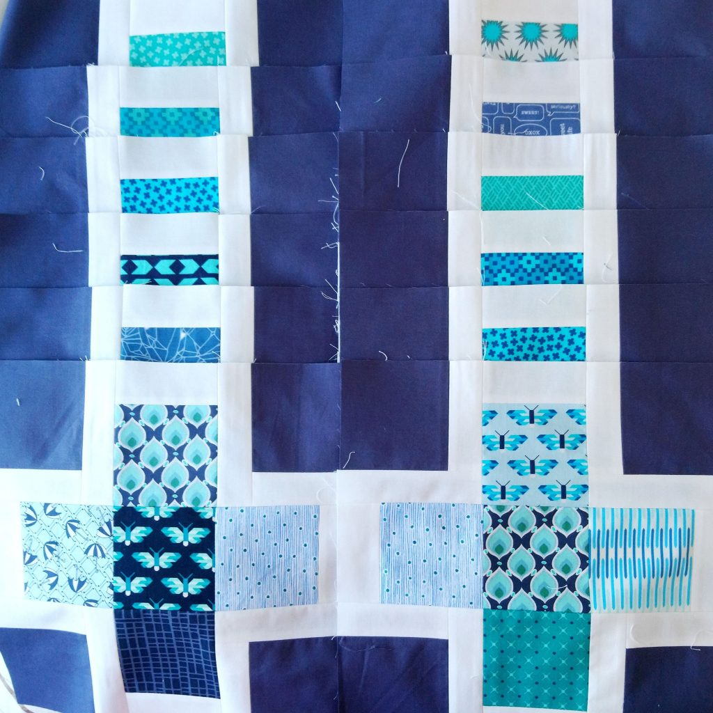 Blocks for Hugo's Quilt laid out in 2 rows.