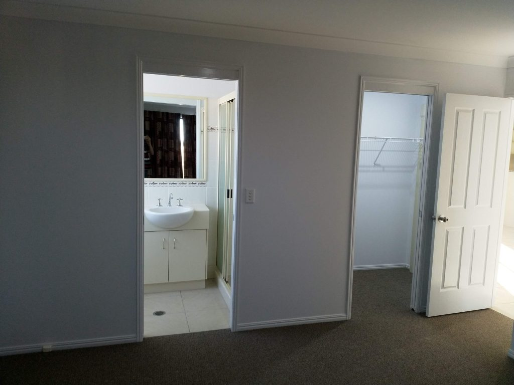 Looking at the ensuite and wardrobe doors before moving in