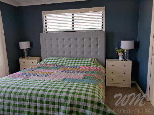 Back of quilt on the king size bed in the master bedroom.
