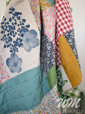 Close up of the quilt draped on the ladder in the guest room.