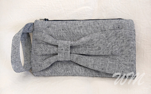 Indigo Essex Yarn Dyed Linen Bow Front Clutch zipper closed