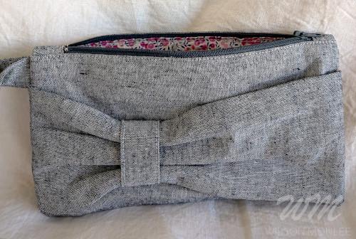 Indigo Essex Yarn Dyed Linen Bow Clutch zipper open showing lining.