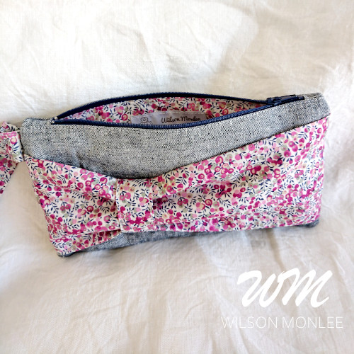 Wiltshire Bud and Indigo Essex Yarn Dyed Linen Bow Clutch zipper open showing lining.
