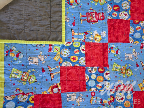 Full Frame Quilt showing backing, quilting and binding
