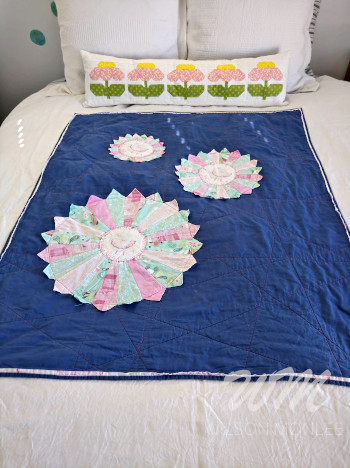 Full shot of Ballerina Quilt on guest bed