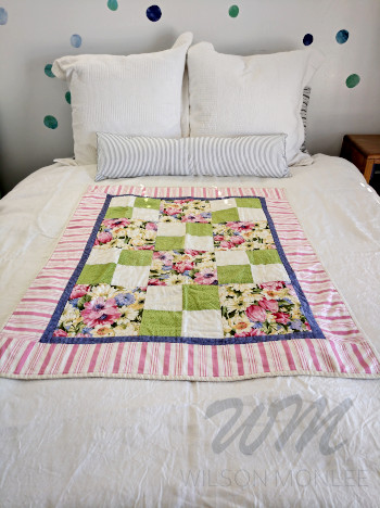 First quilt spread out on spare bed