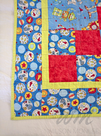 Corner of Robot Quilt showing quilting and binding.