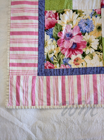Corner of first quilt showing binding and close of prints