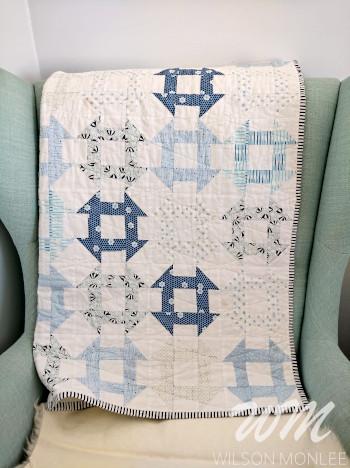 Churn dash quilt on mint chair