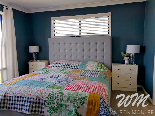 Wide shot of the master bedroom showing the top of the quilt.